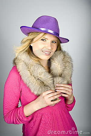 Beautiful elegant woman with hat and fur
