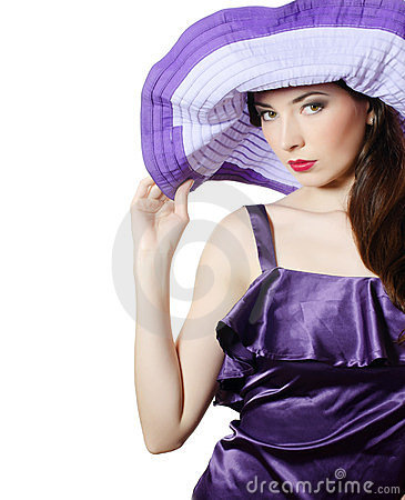 Beautiful elegant woman in a lilac hat
