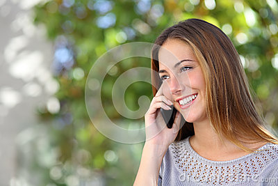 Beautiful and elegant woman on the mobile phone