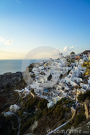 Free Beautiful Evening Light Scene Of Oia White Building Townscape Blending Along Island Mountain, Vast Ocean, Soft Cloud And Blue Sky Royalty Free Stock Image - 108866316