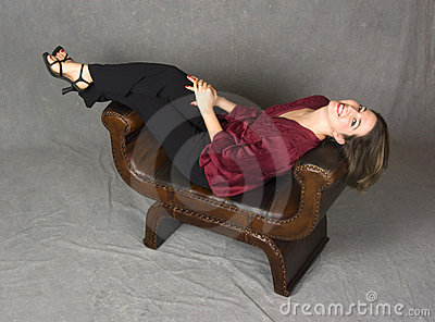 Beautiful everyday woman reclining