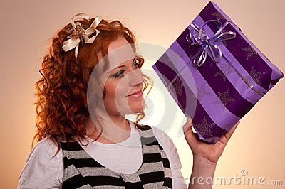 Beautiful excited girl with a presents