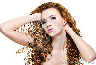 Beautiful expressive woman with  long curly hairs