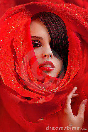 Beautiful face in red roses petals