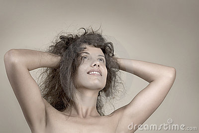 Beautiful face of young woman with curly hairs