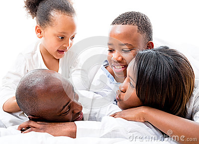 Beautiful family lying in bed
