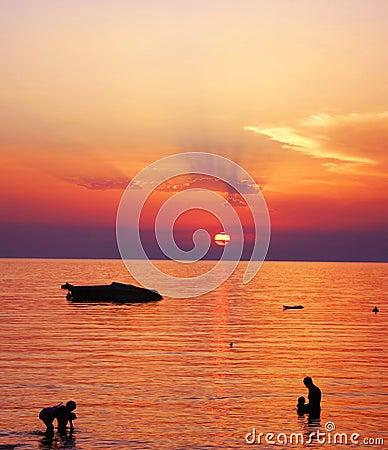 Beautiful Family Sunset on Sea