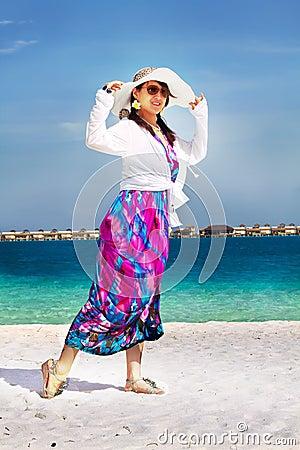 Beautiful fashion asian girl walks on beach