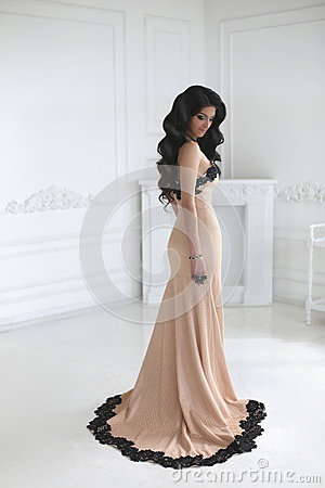 Free Beautiful Fashion Brunette Woman In Elegant Dress With Long Wavy Stock Photos - 75308373