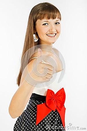 Beautiful Fashion Girl showing thumb up