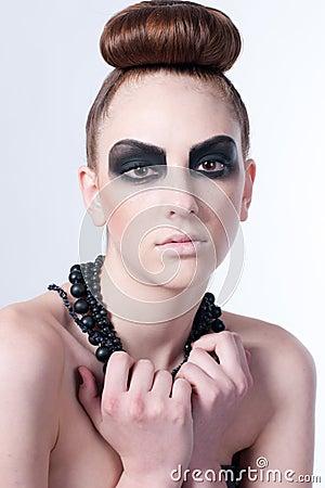Beautiful fashion model with black make-up