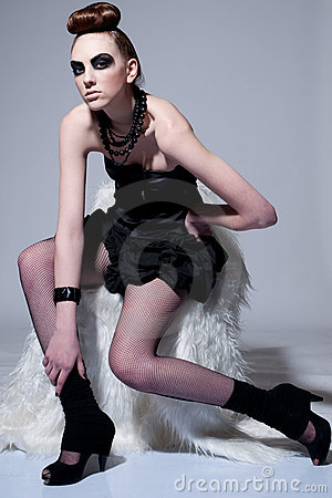 Beautiful fashion model with black make-up