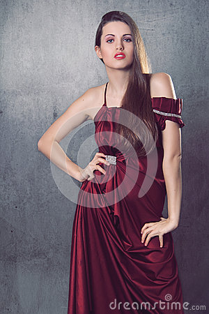 Beautiful fashion model in elegant red dress