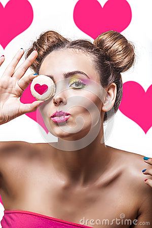 Free Beautiful Fashion Model Girl With Cookies With Hearts On Pink Ba Stock Photo - 56268400