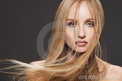 Beautiful fashion model woman with long shiny hair