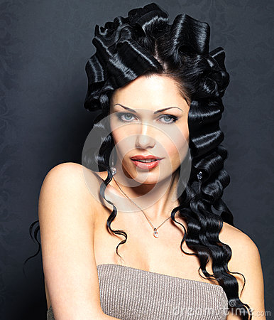 Beautiful fashion sexy  woman with curly hairstyle