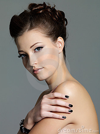 Beautiful fashion woman with black manicure