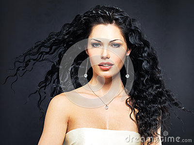 Beautiful fashion woman with curly hairstyle