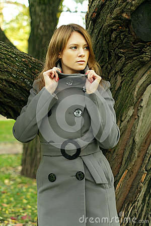 Beautiful fashion woman in fashionable coat
