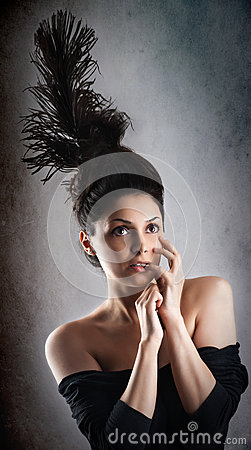 Beautiful fashion woman model with chignon on her head posing in studio
