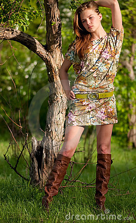 Beautiful fashion woman posing outdoor
