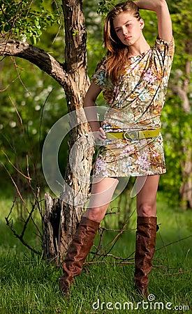 Beautiful fashion woman posing outdoor