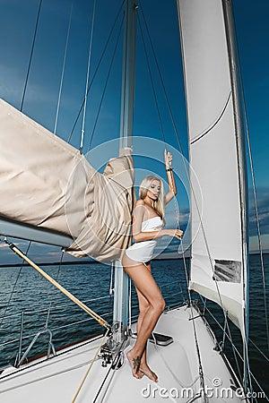 Free Beautiful Fashionable Blonde Girl In Bikini And T-shirt Posing On A Yacht Ship Stock Photography - 107520922
