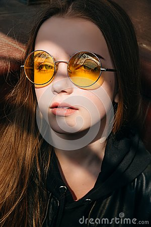 Free Beautiful Fashionable Teenager Girl With Long Blonde Hair In Yellow Sunglasses In City, Street Fashion Kid, Stock Photos - 122220953