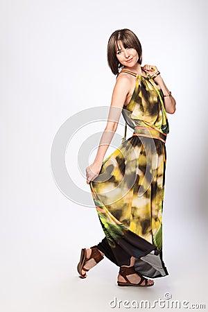 Beautiful fashionable woman in green dress
