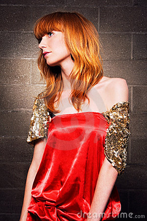 Beautiful fashionable woman in a red dress