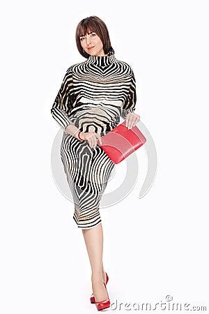 Beautiful fashionable woman in striped costume