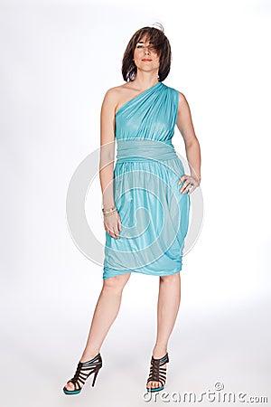 Beautiful fashionable woman in turquoise dress.
