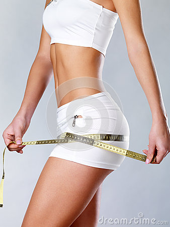 Beautiful feamle body with measuring tape.