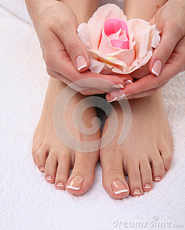 Beautiful feet with perfect spa french nail