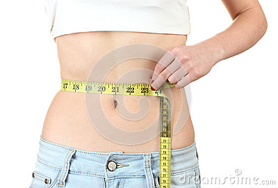 Beautiful female abdomen and measuring tape