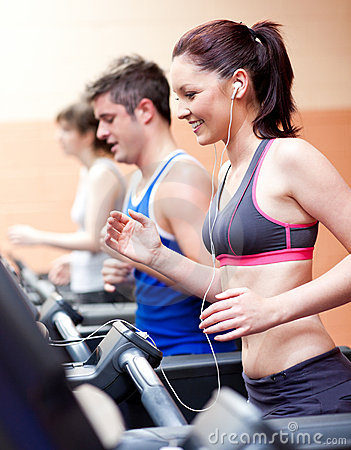 Free Beautiful Female Athlete Standing On A Treadmill Royalty Free Stock Photography - 16347527