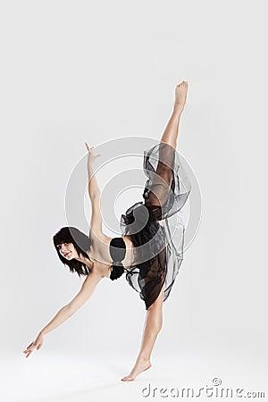 Beautiful female ballerina doing split