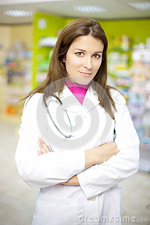 Beautiful female doctor working in pharmacy