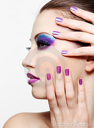 Beautiful female face with bright fashion make-up