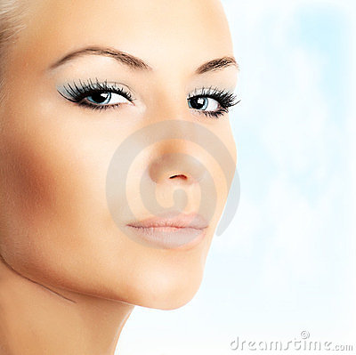 Free Beautiful Female Face Over Blue Sky Background Stock Photos - 23885873