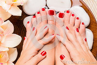 Beautiful female feet at spa salon on pedicure procedure