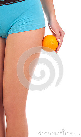 Beautiful female figure with an orange.