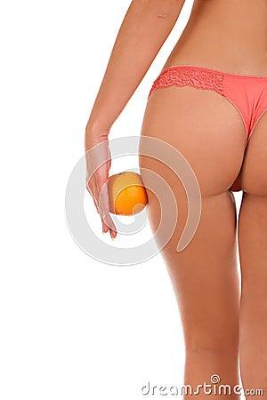 Beautiful female figure with an orange.