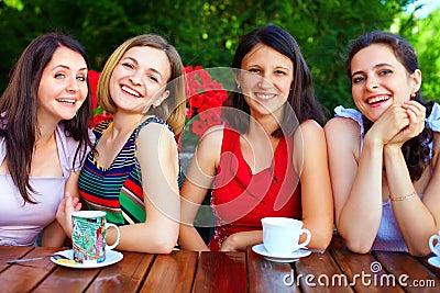 Beautiful female friends in summer cafe
