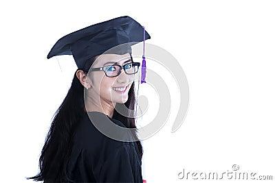 Beautiful female graduate smiling on white