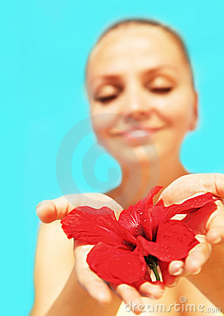 Beautiful female holding red flower