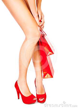 Beautiful female legs, red fashion, shopping