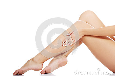 Beautiful female legs touched by hand