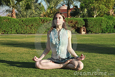 Beautiful female in the lotus position looking up