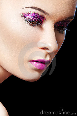 Beautiful female model, violet glitter eye-make-up